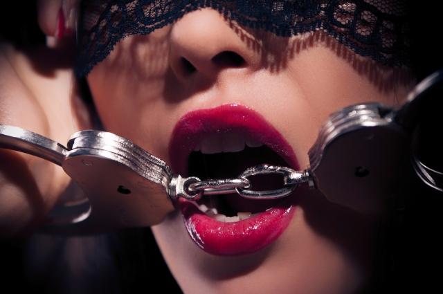 bigstock-Dominating-Beauty-In-Handcuffs-48364535[1]